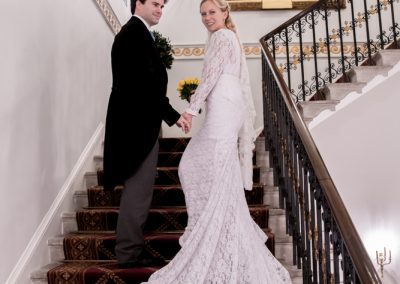 bride and groom on the stairs